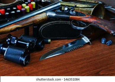 hunting equipment on a wooden board