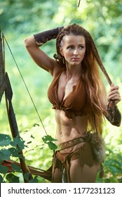 Hunting girl Amazon combing her hair in the forest