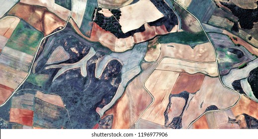 the hunting ground,tribute to Picasso, abstract photography of the Spain fields from the air, aerial view, representation of human labor camps, abstract, cubism, abstract naturalism,