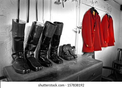Hunting jackets hanging & polished boots