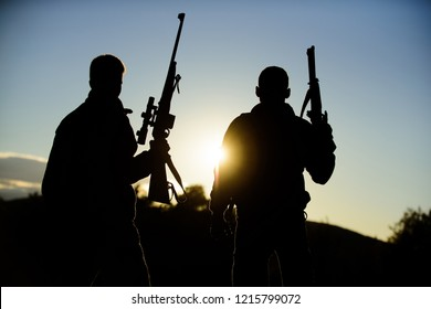 Hunting with partner provide greater measure safety fun and rewarding. Hunters friends gamekeepers with guns silhouette sky background. Hunters rifles nature environment. Hunter friend enjoy leisure.