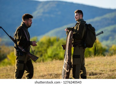 Hunting with partner provide greater measure safety often fun and rewarding. Hunters rifles nature environment. Hunter friend enjoy leisure. Hunters friends gamekeepers walk mountains background.