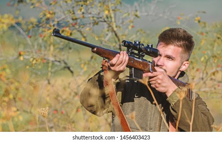 Hunting permit. Bearded hunter spend leisure hunting. Hunting equipment for professionals. Hunting is brutal masculine hobby. Man aiming target nature background. Hunter hold rifle. Aiming skills.