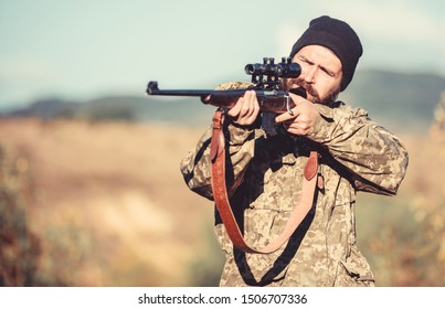 Hunting permit. Man brutal gamekeeper nature background. Bearded hunter spend leisure hunting. Hunter hold rifle. Focus and concentration of experienced hunter. Hunting and trapping seasons.