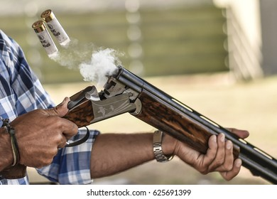 Hunting rifle cartridges and smocke after firing. Hunting in the forest, hunting and clay shooting at the polygon