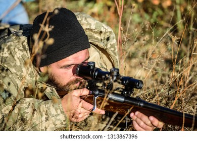 Hunting skills and weapon equipment. How turn hunting into hobby. Bearded man hunter. Army forces. Camouflage. Military uniform fashion. Man hunter with rifle gun. Boot camp. Army soldiers.