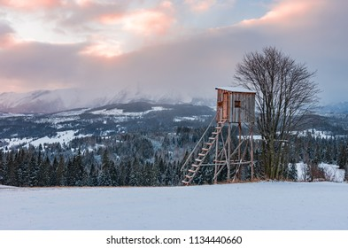 Hunting tower on colorful winter sunrise