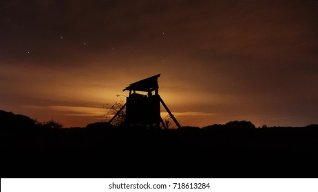 Hunting tower silhouette at night