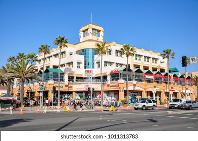 HUNTINGTON BEACH, CA - APRIL 12, 2011 - People walk, shop and dine on a beautiful spring day.