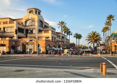HUNTINGTON BEACH, CA - APRIL 12, 2011 - People Walk, shop and dine on Main street in Huntington Beach, California