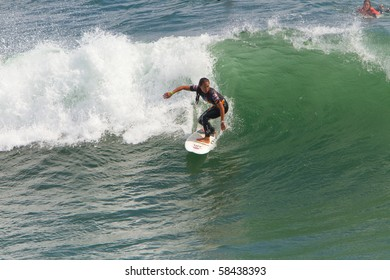 HUNTINGTON BEACH, CA - AUG 2: Karina Petroni of the U.S. performs in the Women's heat of the US Open of Surfing Championships on Monday August 2, 2010.  The event will run to August 8, 2010.