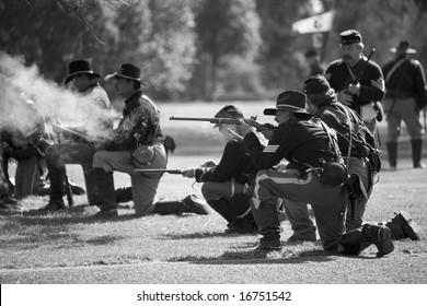 HUNTINGTON BEACH, CA Aug 30, 2008:  Civil war re-enactors performing a battle at the Huntington Central Park, in Huntington Beach, California.  A company of cavalry men firing their carbines.