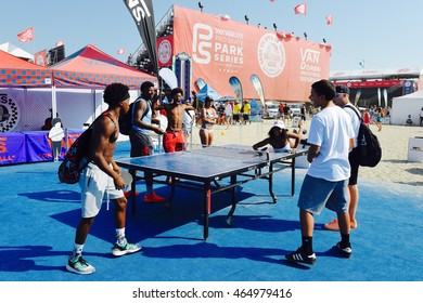 HUNTINGTON BEACH, CA - JULY 30:  Fans participate in ping pong games the 2016 Vans U.S. Surf Open on July 30, 2016 in Huntington Beach, CA.
