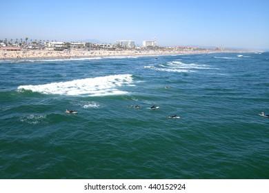 Huntington Beach, CA - JUNE 20: Surfers in the water along Huntington Beach California