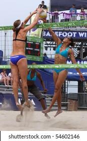 HUNTINGTON BEACH, CA - JUNE 5: Jenny Johnson Jordan hits against the block of Nicole Branagh at the AVP pro volleyball tournament June 5, 2010 in Huntington Beach, CA