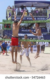 HUNTINGTON BEACH, CA - JUNE 6: Sean Scott hits against the block of Phil Dalhausser in the finals of the AVP pro beach volleyball tournament June 6, 2010 in Huntington Beach, CA