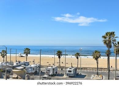 HUNTINGTON BEACH, CA - MARCH 25, 2015: Huntington Beach coastline and RV parking Lot seen from the Pacific City Development.
