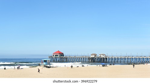 HUNTINGTON BEACH, CA - MARCH 25, 2015: Huntington Beach pier and coastline looking out over the ocean.