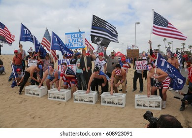 Huntington Beach, CA - March 25 2017: Make America Great Again March. Thousands of Supporters of republican president Donald Trump form a HUMAN CHAIN or WALL OF MEAT to block protesters.