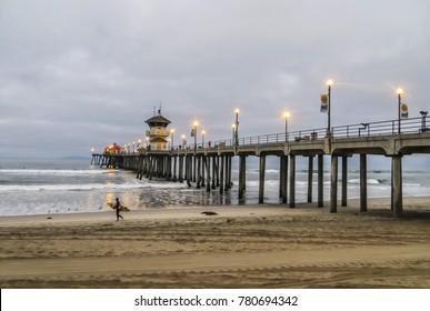 Huntington Beach, CA USA - 08/06/2014 - Huntington Beach, CA USA - Huntington Beach Pier and Surfer at Daybreak