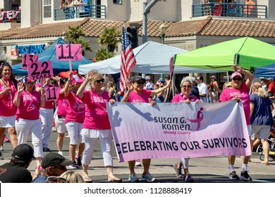 Huntington Beach, CA / USA - July 4, 2018: Huntington Beach Parade 4th of July: women with the Susan G Komen foundation marching in the Independence Day Parade