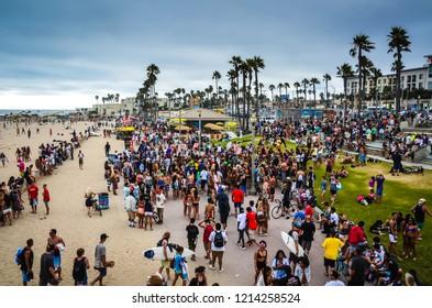 Huntington Beach, CA / USA - July 27, 2013: Crowds of people milling around Huntington Beach.