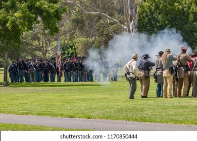 Huntington Beach, CA / USA - September 1, 2018: Soldiers fighting on the battlefield during a Civil War reenactment in Huntington Beach Central Park