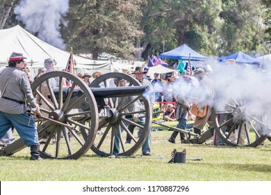 Huntington Beach, CA / USA - September 1, 2018:  civil war soldiers firing a cannon during a civil war reenactment in Huntington Beach Central Park