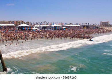 HUNTINGTON BEACH, CA-AUGUST 8: Massive crowds pack the beach for the U.S. Open of Surfing Championships Sunday, August 8, 2010 in Huntington Beach. The event ends Sunday with an award's ceremony.