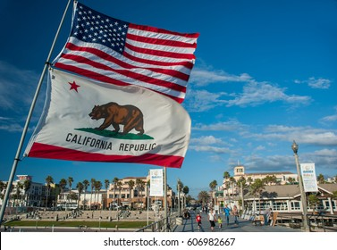 Huntington beach, California - 11th October 2012: The stars and stripes and California state flags fluttering on the pier of Huntington beach California