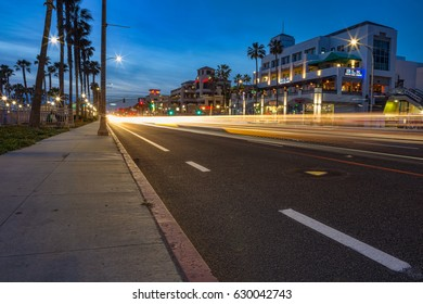 Huntington Beach, California - APRIL 7, 2017: Traffic moves along the Pacific Coast Highway at sunset in Huntington Beach, California.