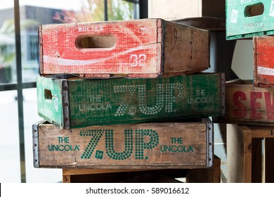 Huntington Beach, California - February 20, 2017: Old 7UP and Coca Cola logos on vintage soda cases stacked in a local shop.