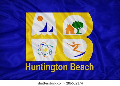 Huntington Beach ,California flag on fabric texture,retro vintage style