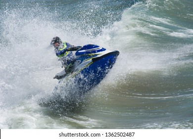 Huntington Beach, California / USA - April 7 2019: Jet skier competing in an offshore PWC surf race at the 2nd Annual Huntington Beach Moto-Surf and Freeride Exhibition.