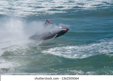 Huntington Beach, California / USA - April 7 2019: Jet skier competing in offshore PWC surf race at 2nd Annual Huntington Beach Moto-Surf and Freeride Exhibition.