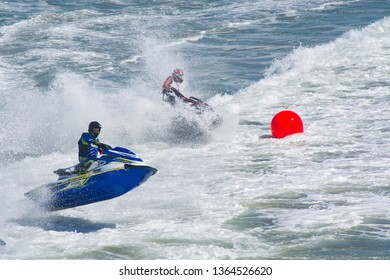 Huntington Beach, California / USA - April 7 2019: Jet skiers competing in an offshore PWC surf race at the 2nd Annual Huntington Beach Moto-Surf and Freeride Exhibition.