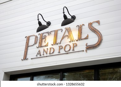 Huntington Beach, California/United States - 03/01/19: A store front sign for the floral and sparking wine shop known as Petals and Pop
