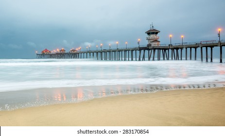 HUNTINGTON BEACH, CA/USA - MAY 15, 2015: Dawn breaks over the Pacific Ocean at Huntington Beach Pier, Huntington Beach State Park.
