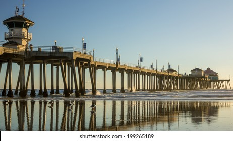 Huntington Beach Pier reflecting on beach