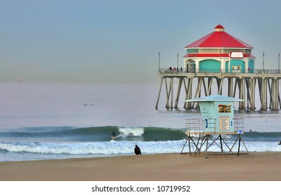 Huntington Beach Pier and Surfer at Dawn during Summer