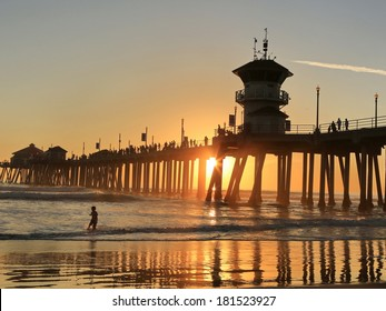 the Huntington Beach pier under sunset