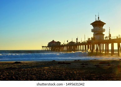 Huntington Beach, USA 10-06-2018 the pier during sunset with the pacific ocean and people watching the landscape