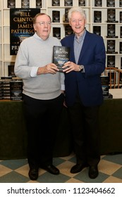 "HUNTINGTON, NY - JUN 28: Author James Patterson (L) and former President Bill Clinton attend the book signing of ""The President is Missing"" at Book Revue on June 28, 2018 in Huntington, New York."