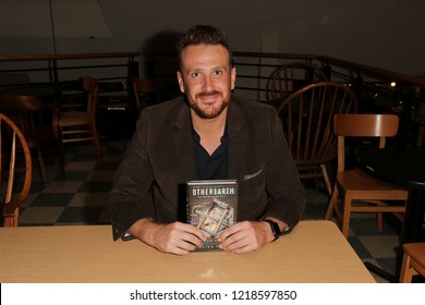 """HUNTINGTON, NY - OCT 30: Actor Jason Segel autographs copies of his book """"OtherEarth - Welcome Back to Reality"""" at Book Revue on October 30, 2018 in Huntington, New York."""