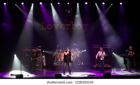 HUNTINGTON - OCT 10: (L-R) Paul Dean, Mike Reno, Matt Frenette, Ken Sinnaveve and Doug Johnson of Loverboy perform in concert at the Paramount on October 10, 2019 in Huntington, New York.