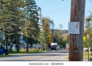 Huntington, VT, USA - October 10, 2013: A local resident advertises fresh eggs with a sign tacked to a telephone pole on Main Street on this sunny autumn afternoon.