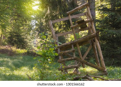 Huntsman high seat stands diagonally in the summer forest