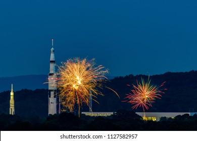 HUNTSVILLE, AL - JULY 4, 2018 - Fireworks explode beside the Saturn V rocket and the Davidson Space Center in Huntsville, Alabama