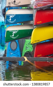 Huntsville, Ontario, Canada. 4/25/2019. Flood water approaches canoes on racks behind outfitter's store in Huntsville Ontario.