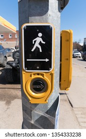 HUNTSVILLE, ONTARIO, CANADA - MARCH 29, 2019: Close up of Road Crossing Signal Button for the Visually Impaired - Creates a loud audible chirping sound to assist safer road crossing